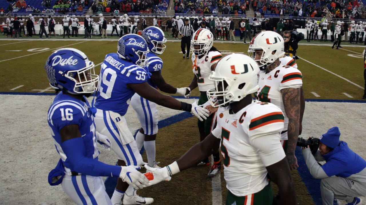 Duke Blue Devils and Miami Hurricanes shake hands before 2019 game