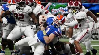Florida Gators QB Kyle Trask leaps into end zone vs. Alabama Crimson Tide in 2020 SEC Championship
