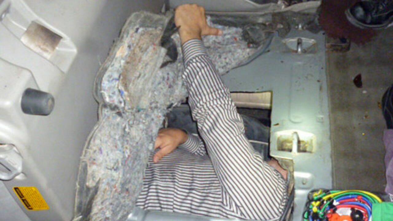 Border officers find man hidden in SUV gas tank