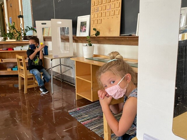 students in school in mask and social distance