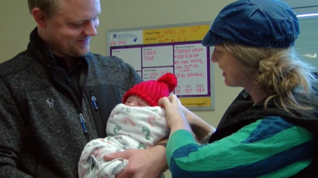 Handmade baby caps raising awareness for congenital heart defects
