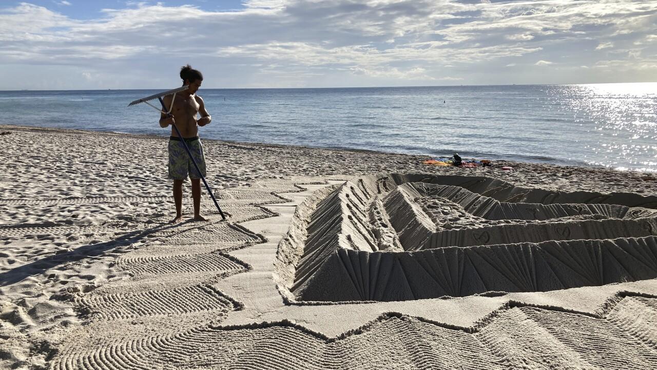 Sand sculptor hopes beach creation honors building victims