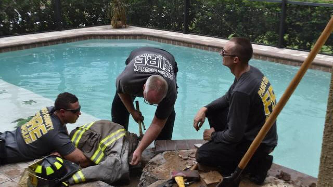 Child's arm gets trapped in pool skimmer pipe