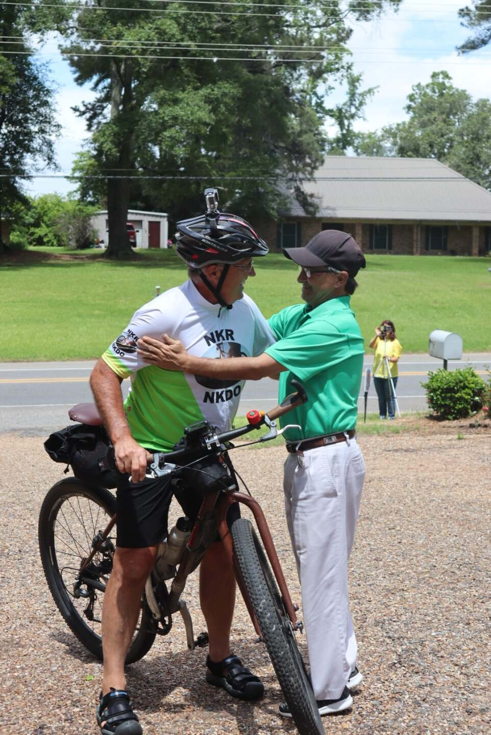 Mark and his friend, Hugh, embrace. Hugh is the inspiration for the ride.
