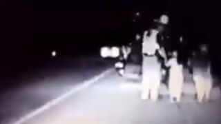 MHP Trooper TJ Templeton comforts a young girl at a crash scene