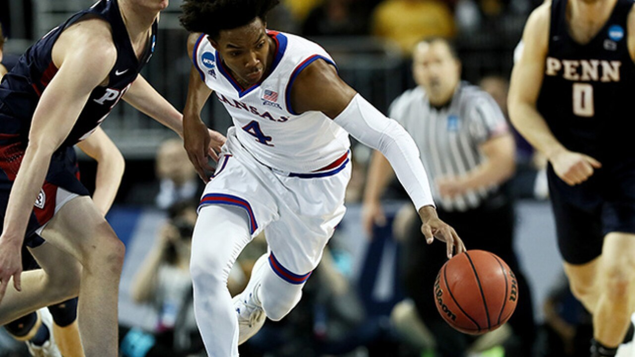 Kansas survives scare against Penn to advance in tourney