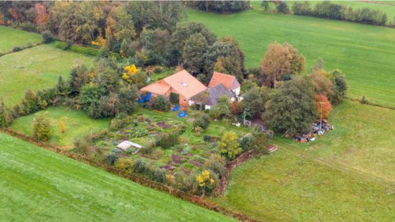 An aerial picture shows a view of the farm where a father and six children had been living in the cellar, in Ruinerwold, northern Netherlands. WILBERT BIJZITTER / ANP / AFP / GETTY IMAGES