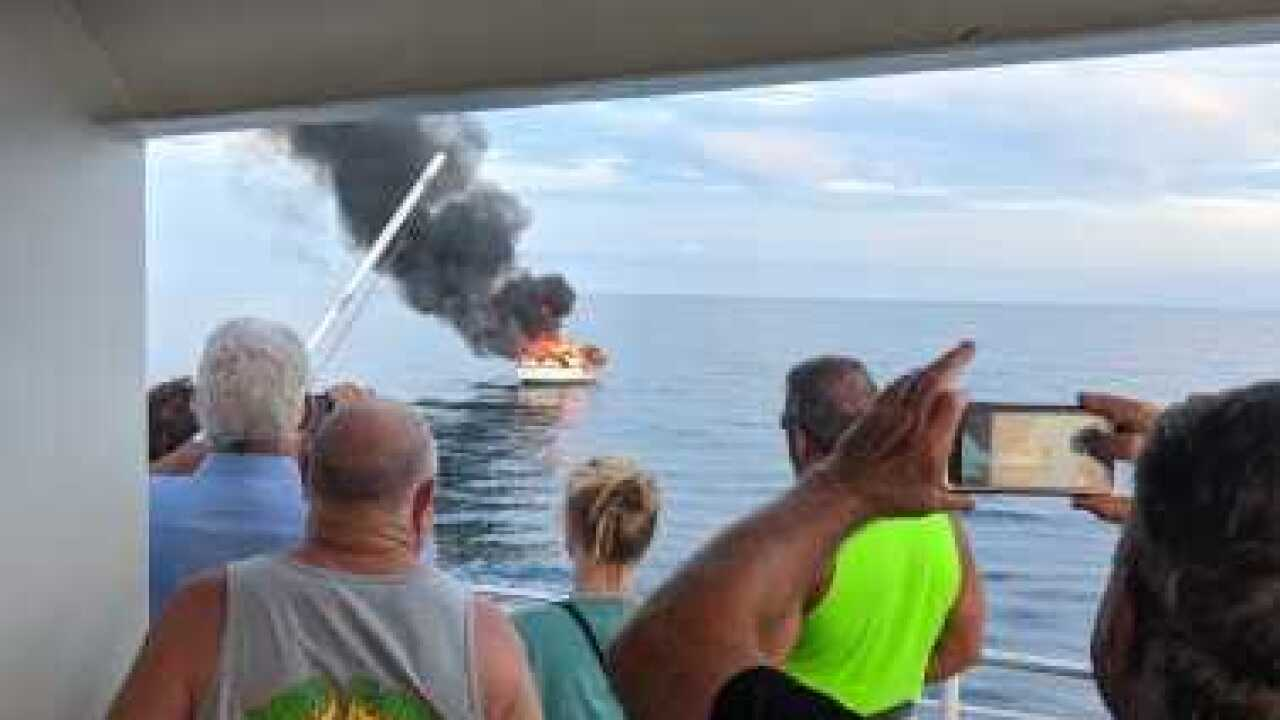 Key West Express saves boaters from fire 1.jpg