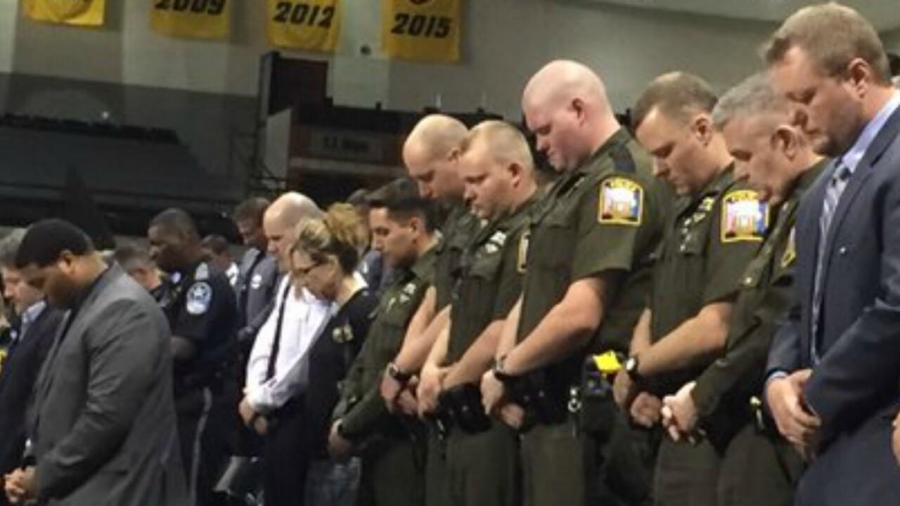 Vigil honors slain trooper Chad Dermyer at SiegelCenter