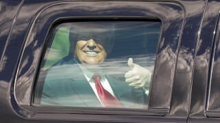 President Donald Trump gives thumbs up to supporters on motorcade route to Mar-a-Lago, Jan. 20, 2021