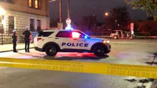 Cincinnati police responded to reports of a shooting early Thursday morning on Western Avenue. The photo shows a police vehicle in the foreground and another vehicle with its doors open in the background.