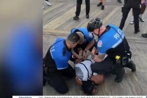 Video show O.C. Police kneeing man