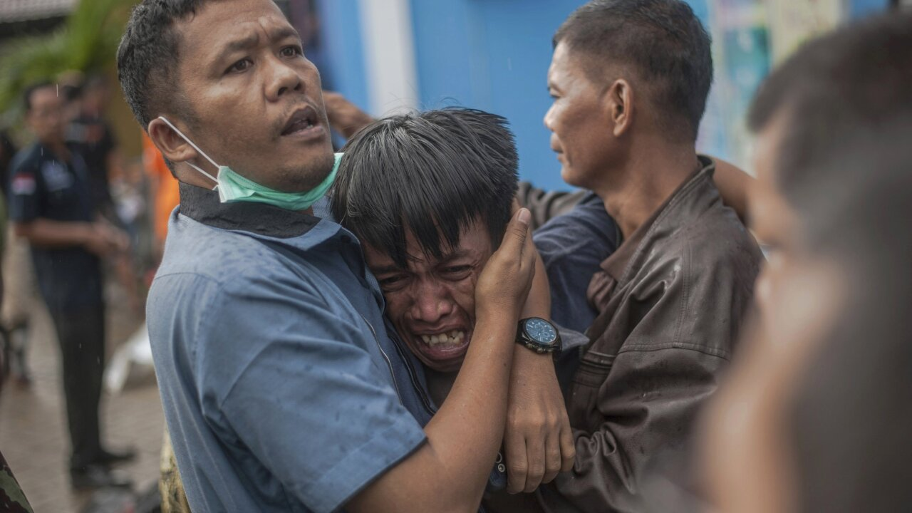 Tsunami strikes without warning, killing 222 in Indonesia