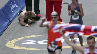 Marine crawls to finish line of the Boston Marathon