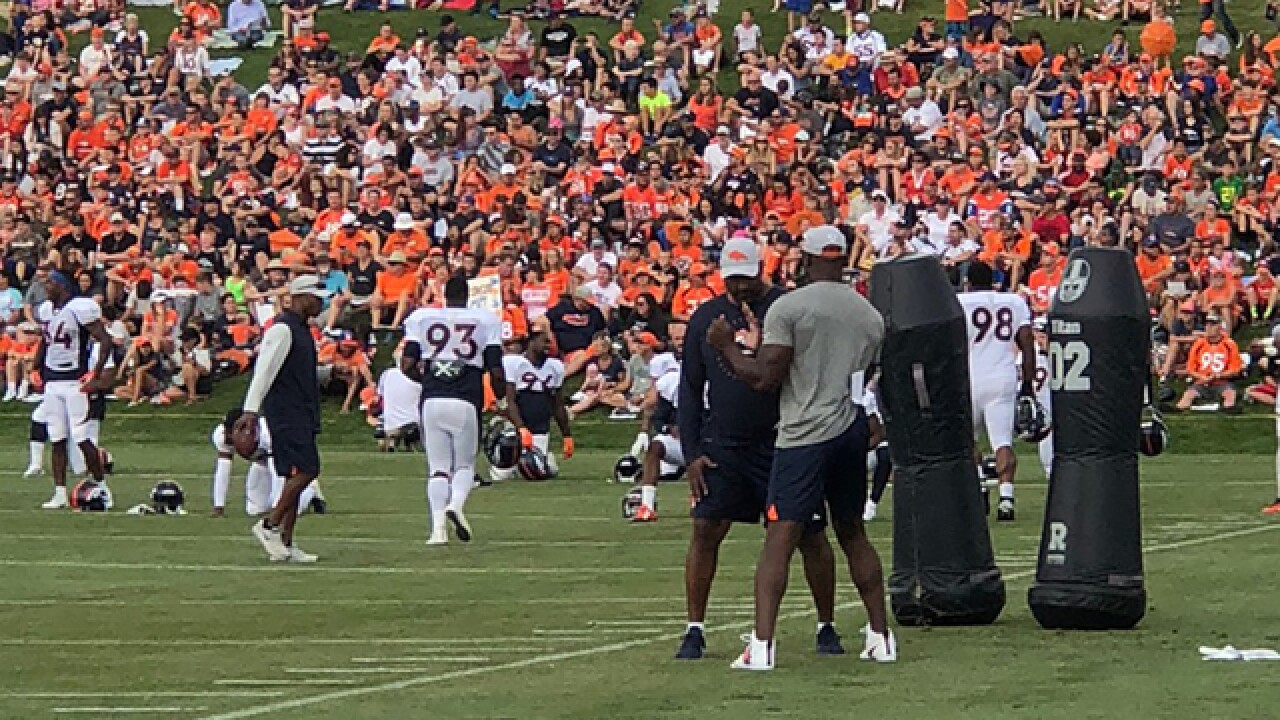 DeMarcus Ware makes Broncos training camp coaching debut