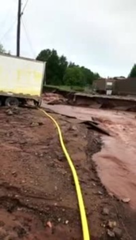 PHOTOS: Flash flooding washes out roads in northern Michigan