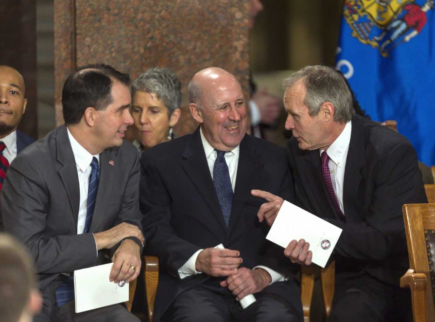 Former Wisconsin Governors Scott Walker, left, Jim Doyle and Scott McCallum were in attendance for Monday's inauguration. (Associated Press photo).