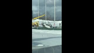 'Unusual hole-in-one': Truck gets stuck in hole while snowplowing atTopgolf