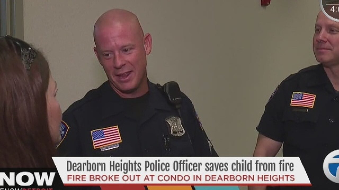 Police officer saves child from house fire