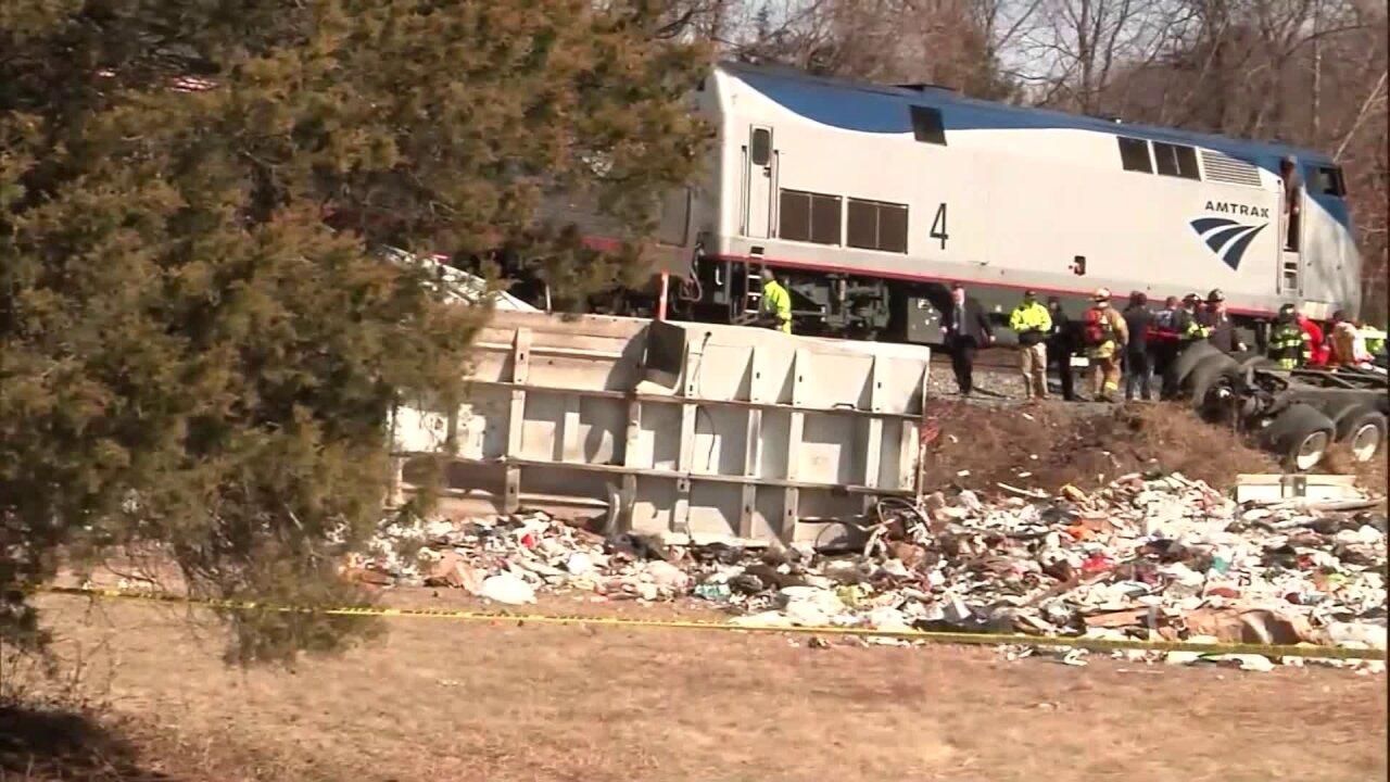 Train crash investigation focusing on truck driver'sactions