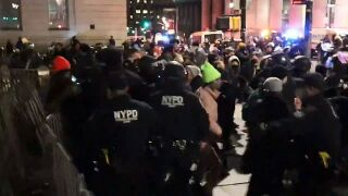 Police clash with protesters at Martin Luther King Day march