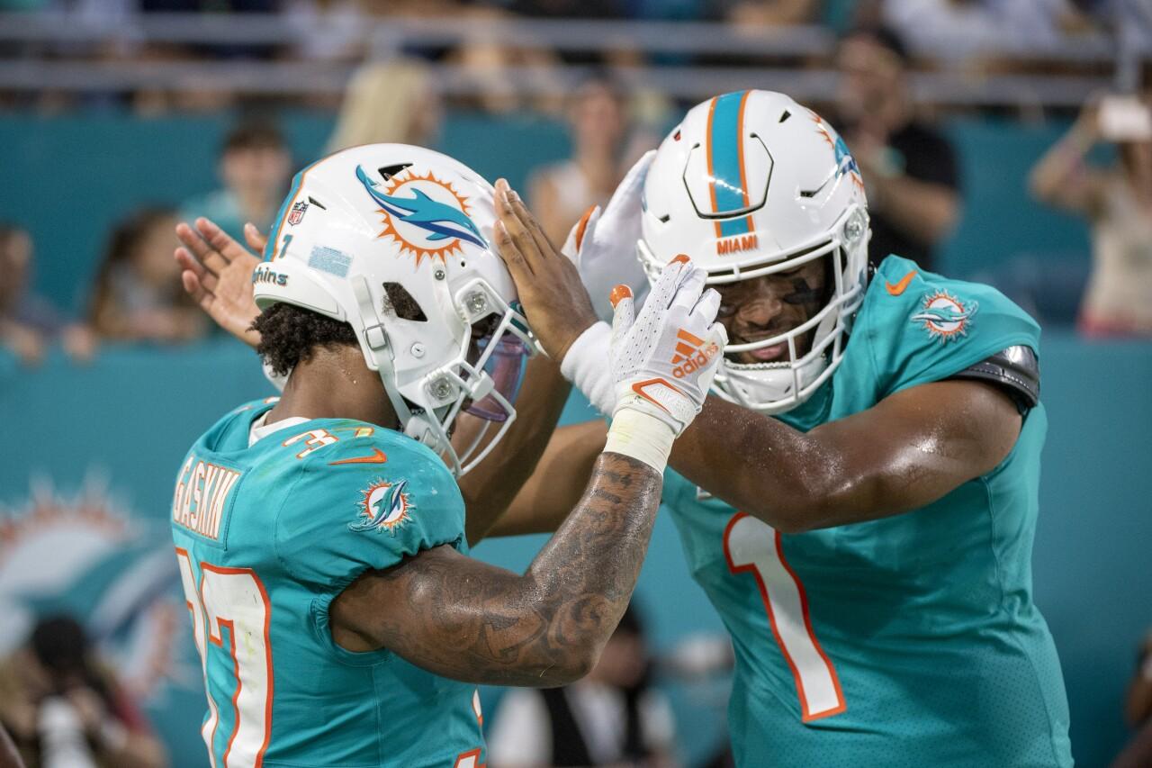 Miami Dolphins QB Tua Tagovailoa celebrates TD with running back Myles Gaskin in 2021 preseason game vs. Atlanta Falcons