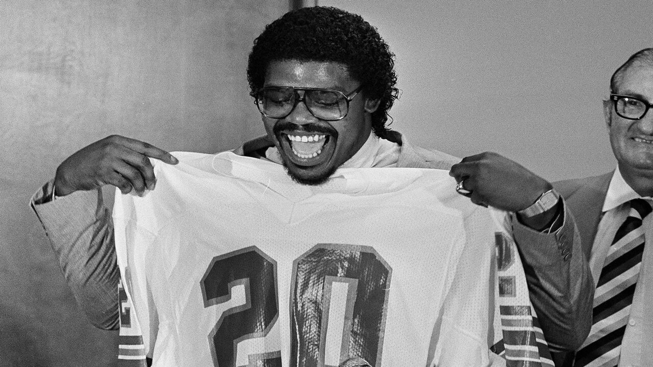 David Overstreet holds Miami Dolphins jersey in 1983