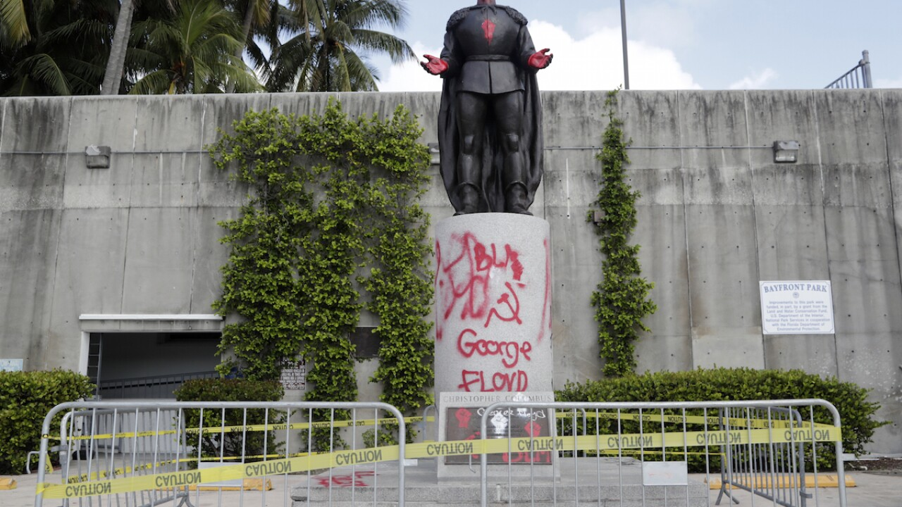 Police: 7 arrested for vandalizing Columbus statue in Miami