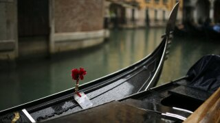 Gondolas are parked on a rainy day in Venice, Sunday, March 1, 2020. Venice in the time of coronavirus is a shell of itself, with empty