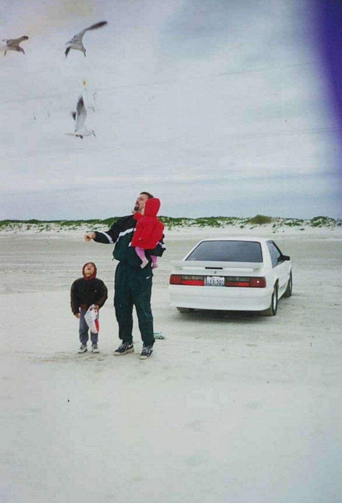 Wesley Ryan is seen here with his beloved 1993 white Ford Mustang GT and his family. He sold the car in 2004 to pay for his wife's medical bills as she battled cancer (Ryan Family).
