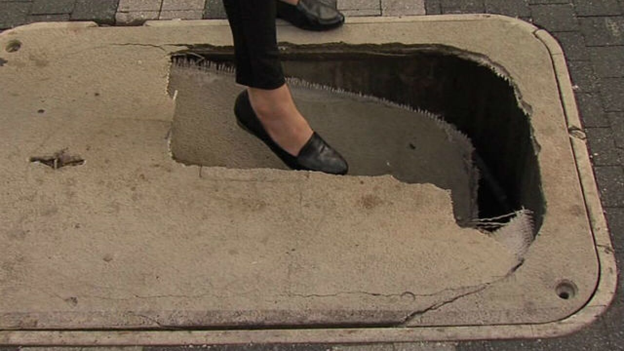 Panel cracks downtown, creates hole in sidewalk
