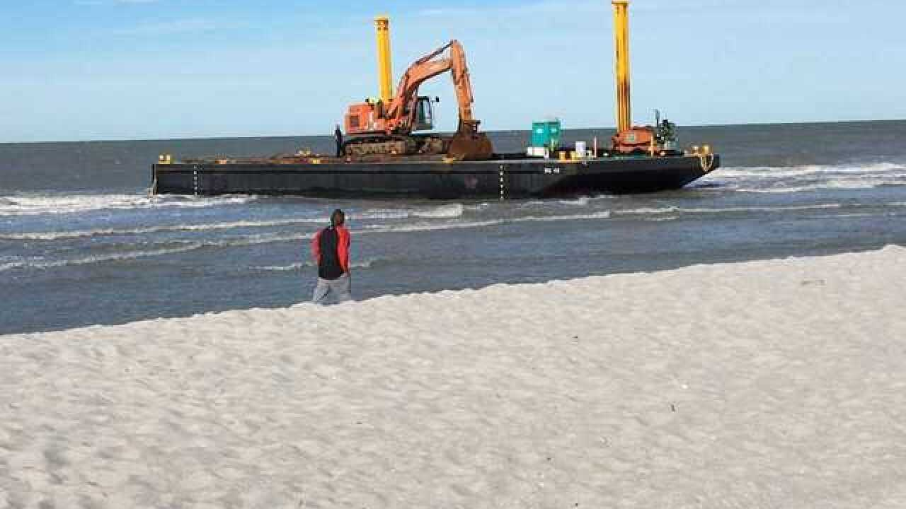 Two work barges beached in Naples