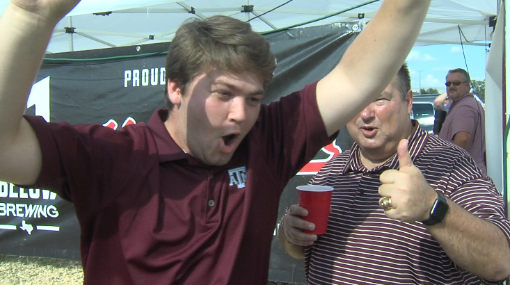 Aggies can barely hold back their excitment for todays game as one photobombs a gig pose but all in good spirit of course.PNG