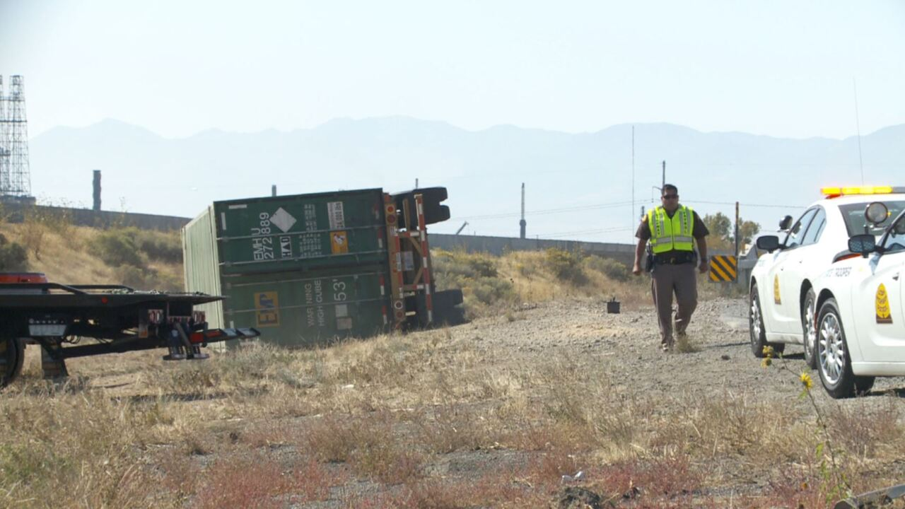 Semitrailer rollover crash forces closure on I-215 in Davis Co.