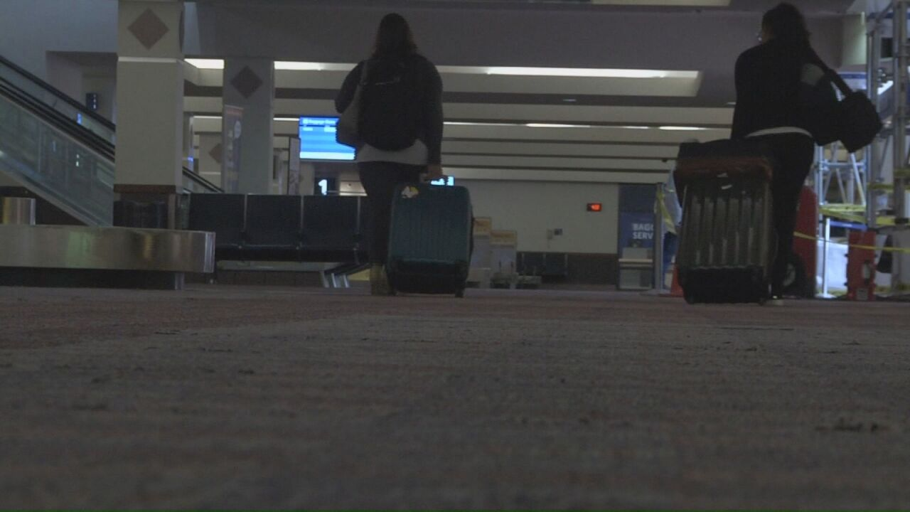 Travelers at the Colorado Springs Airport