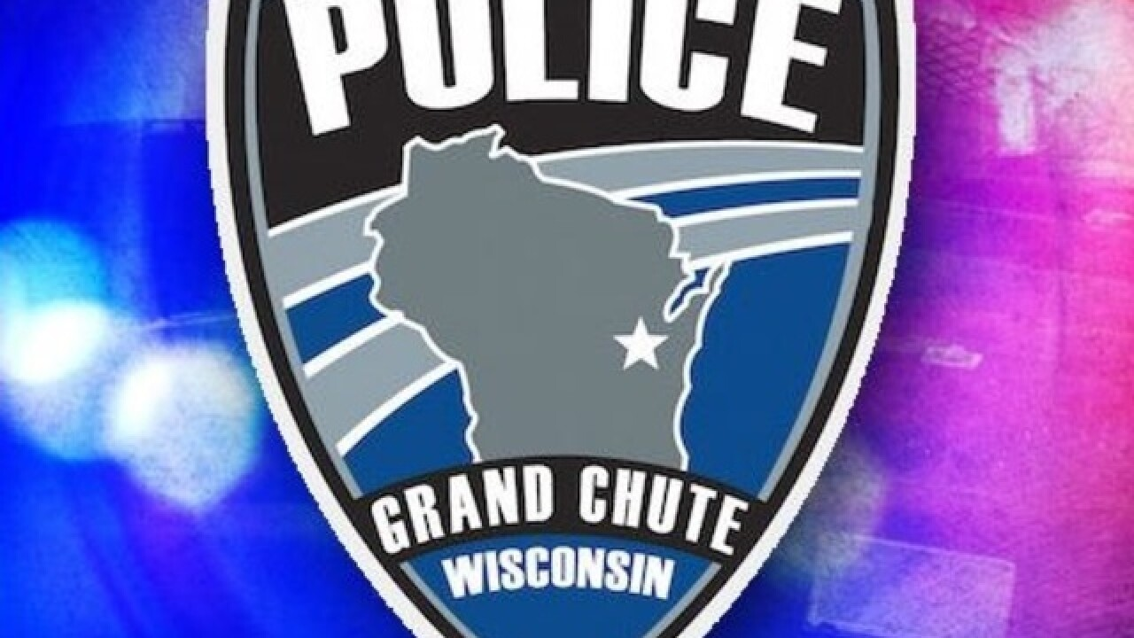 Woman arrested after shots fired in Grand Chute parking lot