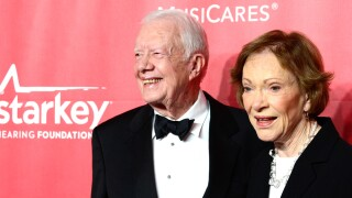 Former U.S. President Jimmy Carter (L) and former First Lady Rosalynn Carter attend the 25th anniversary MusiCares 2015 Person Of The Year Gala honoring Bob Dylan at the Los Angeles Convention Center on February 6, 2015 in Los Angeles, California. The annual benefit raises critical funds for MusiCares' Emergency Financial Assistance and Addiction Recovery programs.