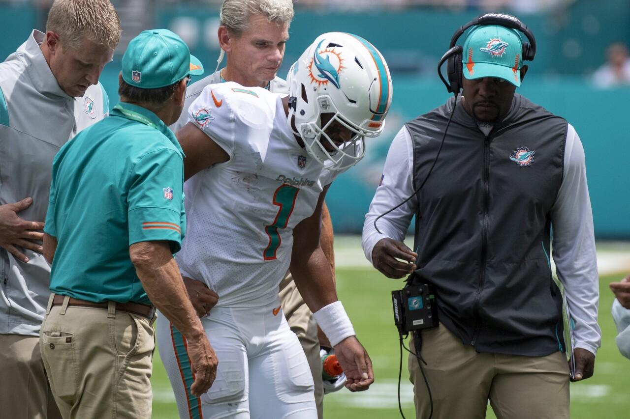 Miami Dolphins QB Tua Tagovailoa helped off field after rib injury vs. Buffalo Bills, Sept. 19, 2021