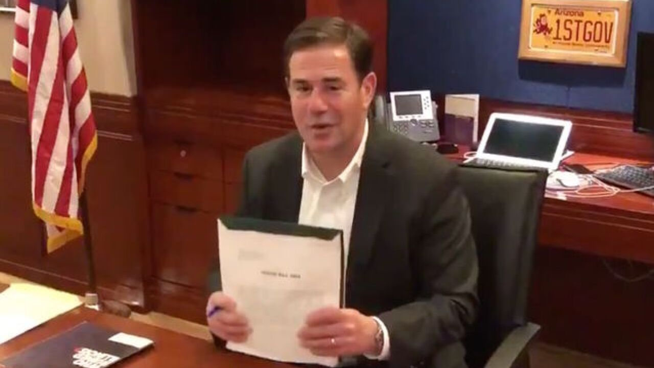 Ducey says he will sign approved budget plan