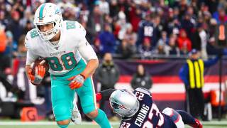 Mike Gesicki #88 of the Miami Dolphins scores a touchdown in the fourth quarter during a game against the New England Patriots at Gillette Stadium on December 29, 2019 in Foxborough, Massachusetts.