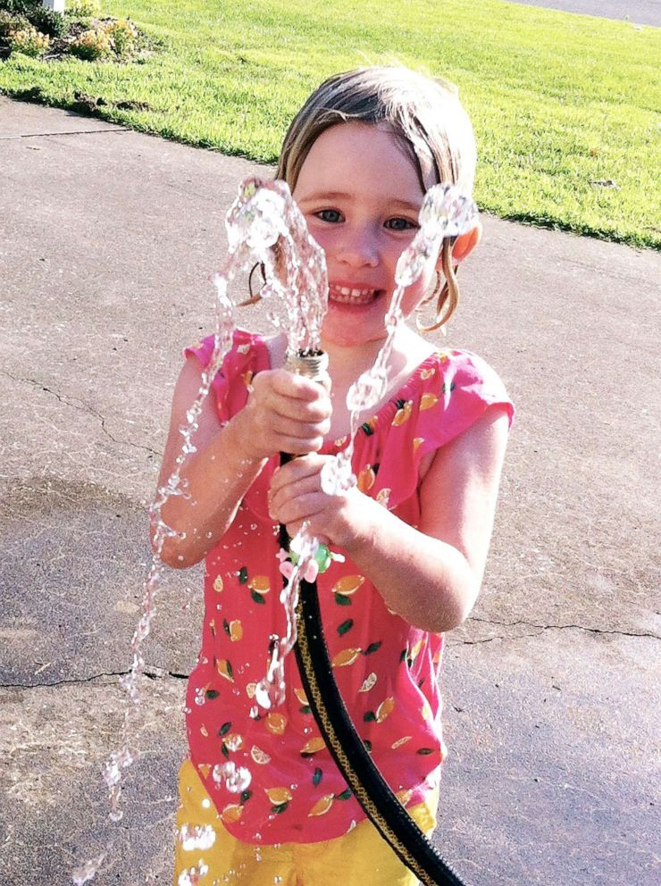 Courtesy Laura Sullivan-BeckersSylvie plays with water from a hose in this undated family photo.