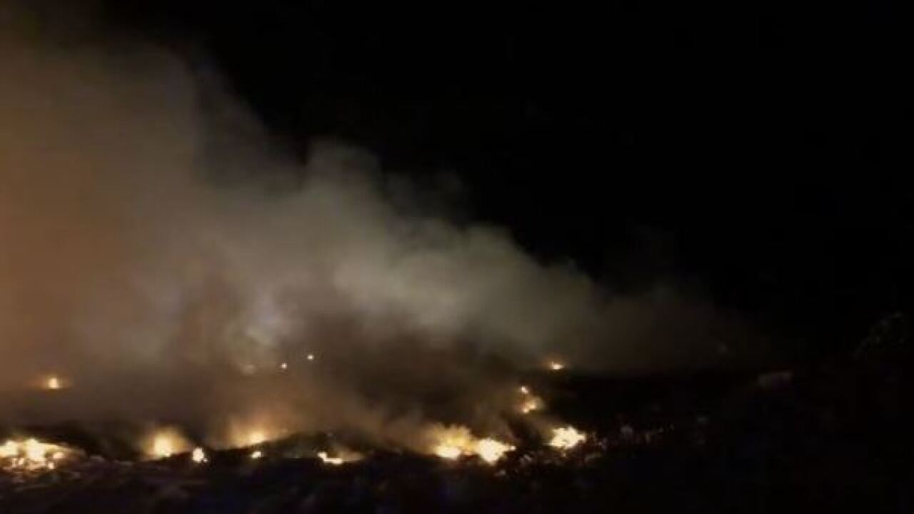 Crews working to extinguish landfill fire