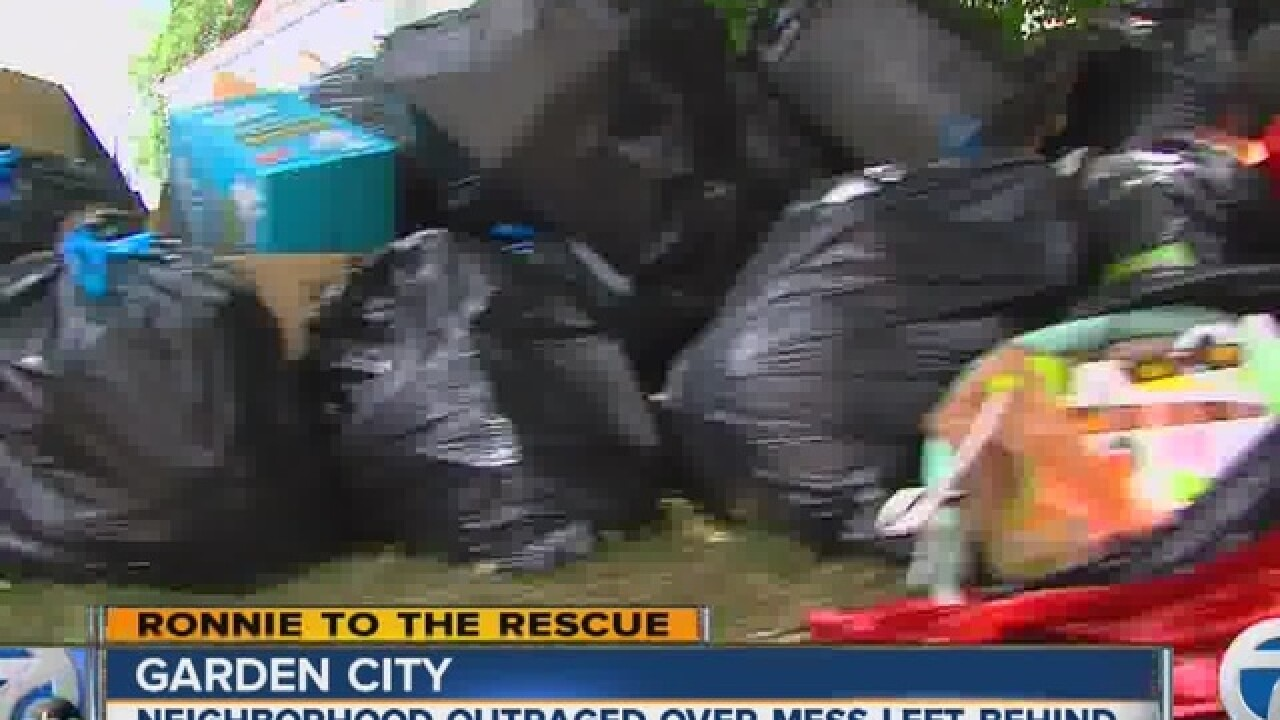 New owner hires company to clean up trash pile left in yard of his Garden City home