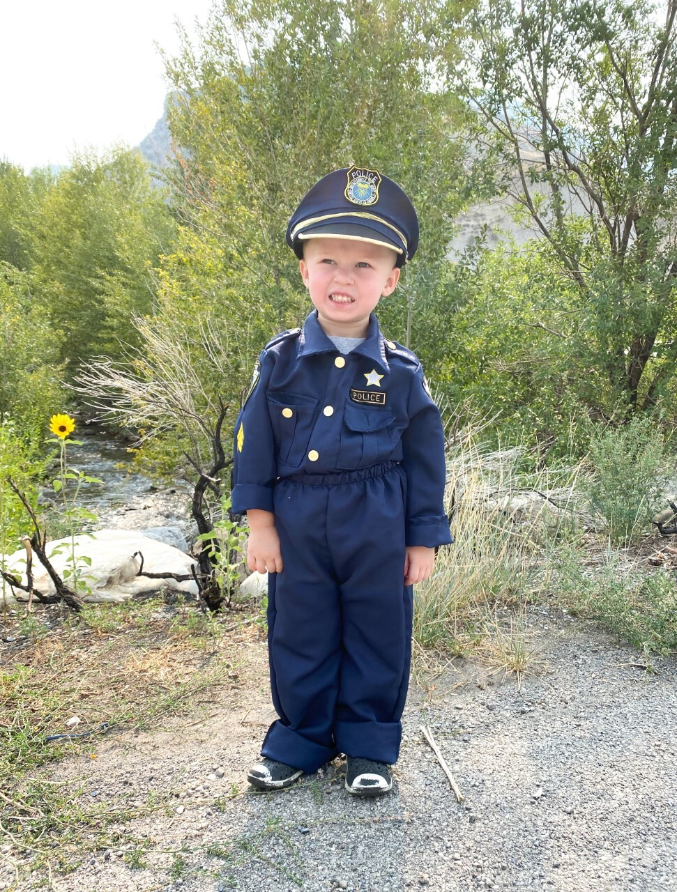 Boy dressed as police office
