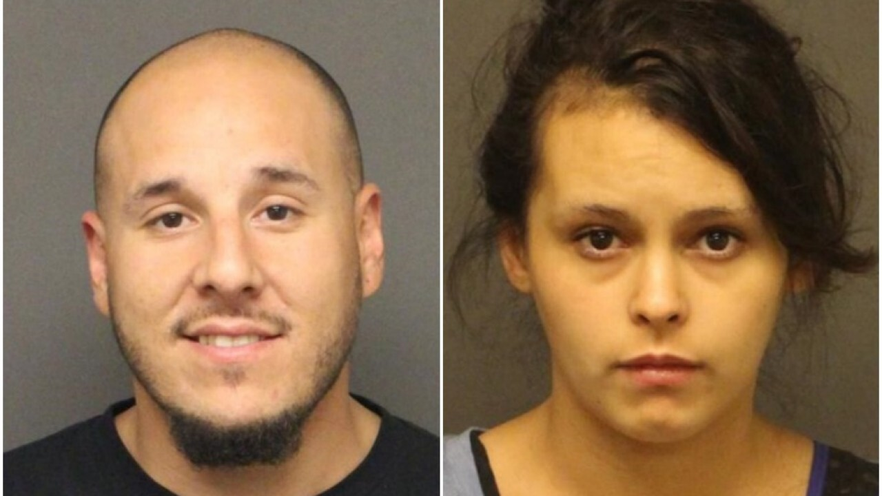Two arrested in Kingman after body found buried inside 55-gallon drum