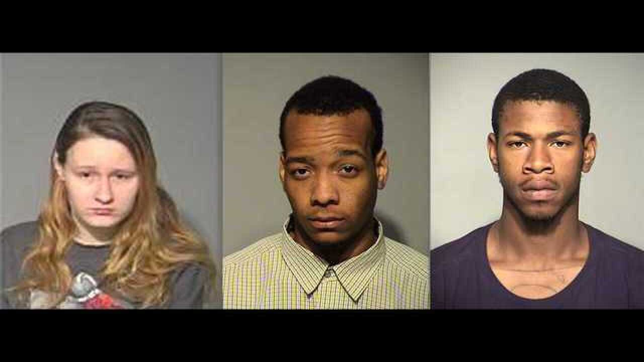 3 charged in woman's murder outside workplace