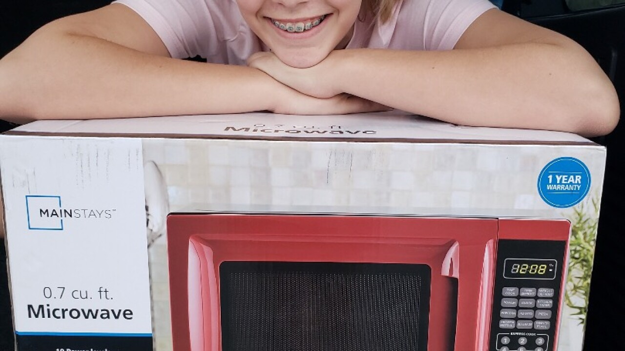 Josephine with microwave.jpg