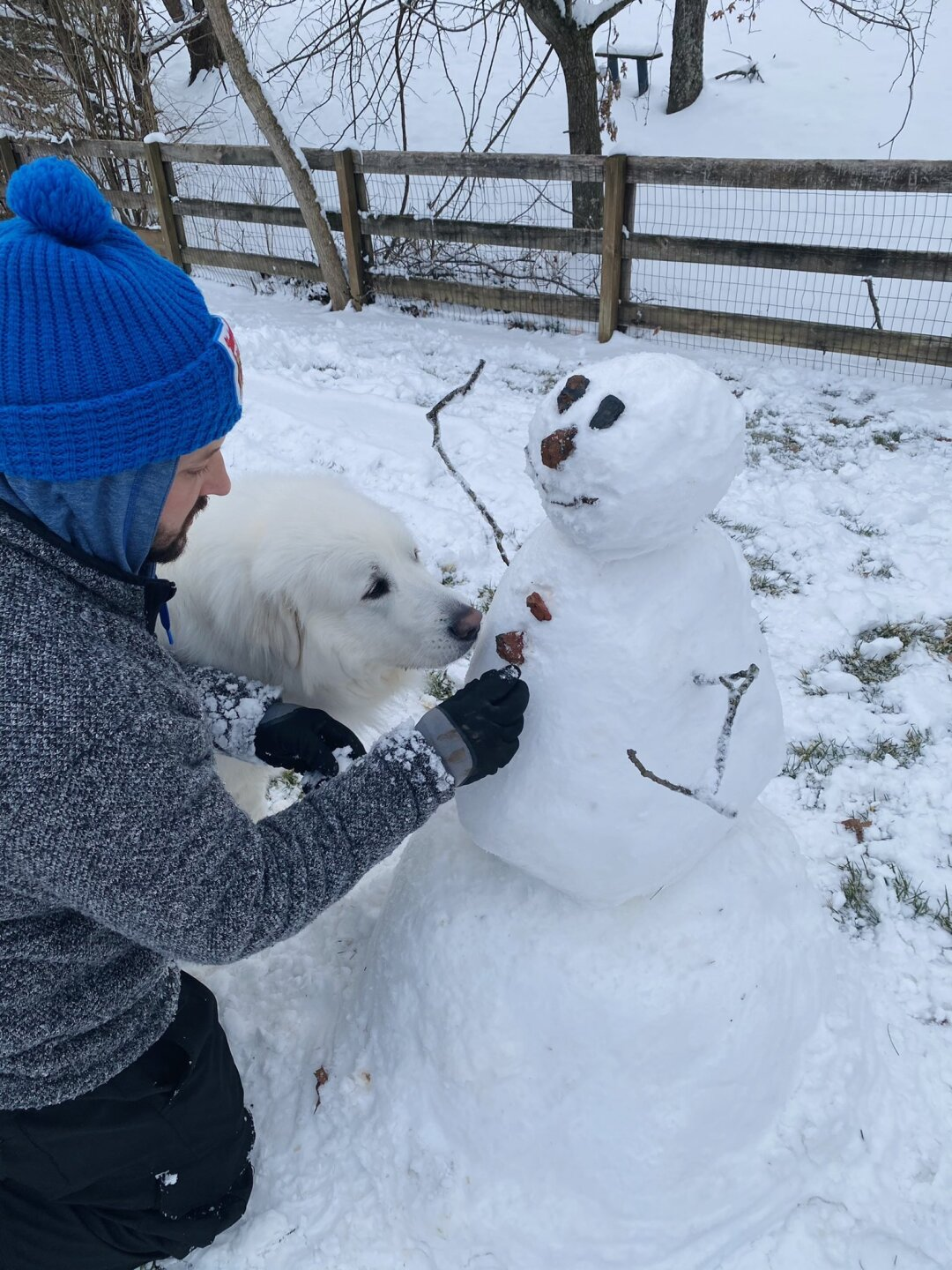 Mitchell working on Lumpy the Snowman while Luna looks over his shoulder to make sure he's doing a good job.jpg