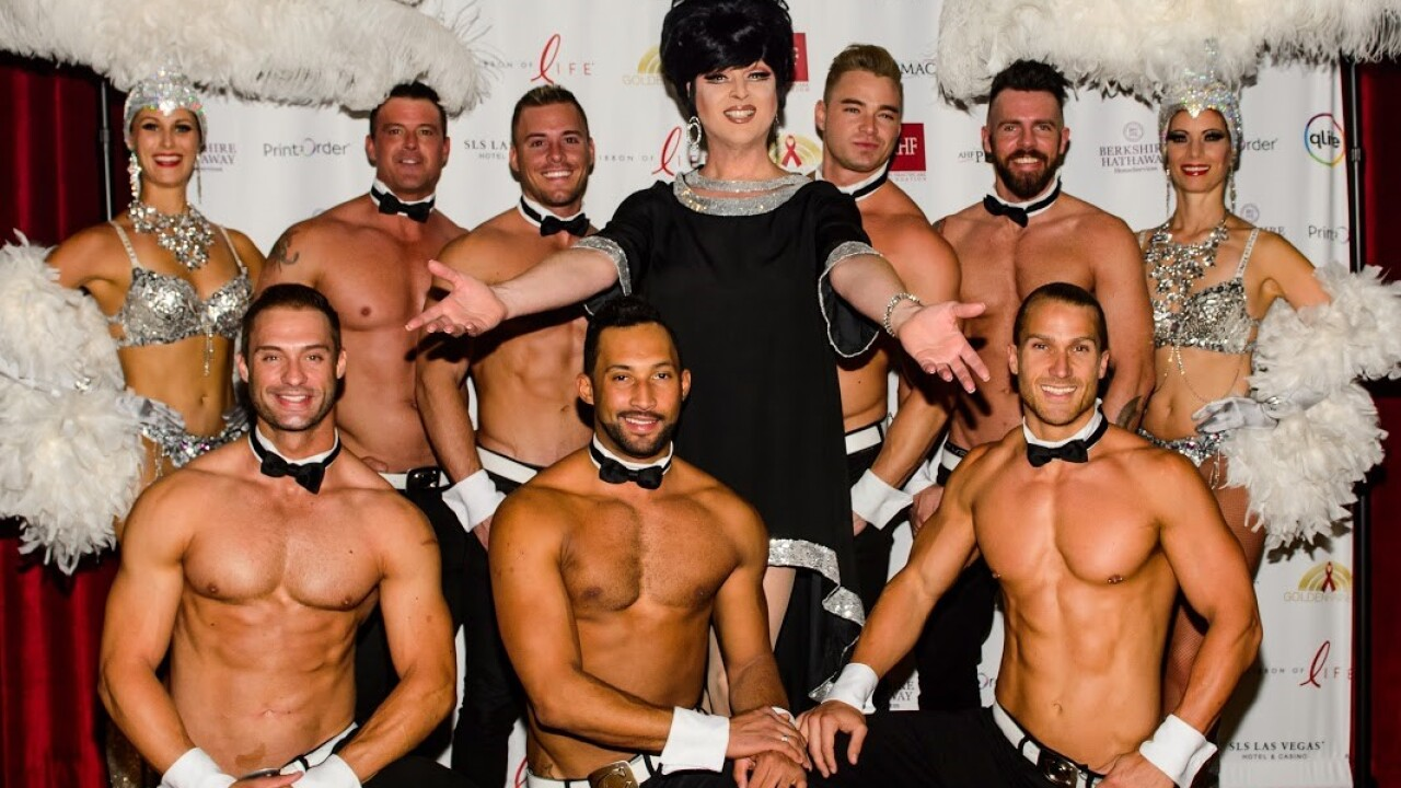 EDIE poses with Chippendale cast members
