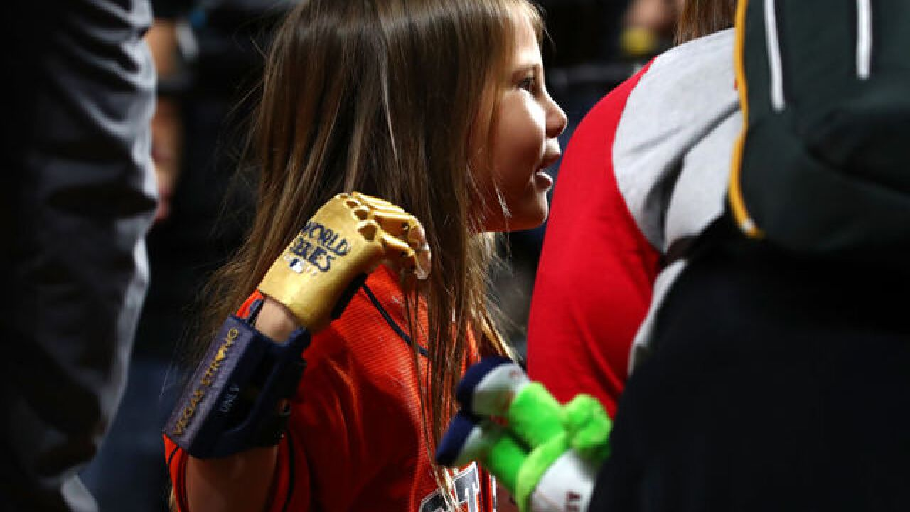 Henderson girl throws 1st pitch at World Series